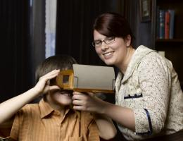 Interpreter and child with stereoscope